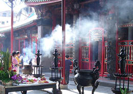 offering incense in a temple